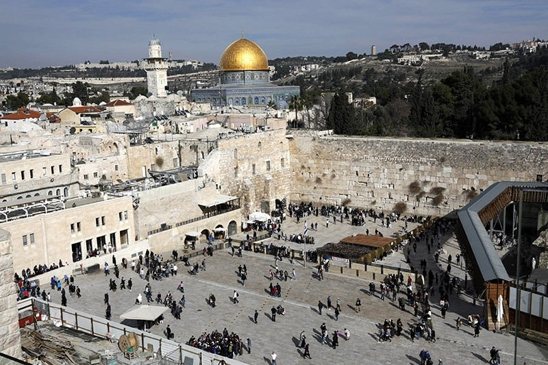 Visitors gather at the Western Wall plaza with the Dome of the Rock in the background, at the Old City of Jerusalem, 03 January 2018. (EPA Photo)