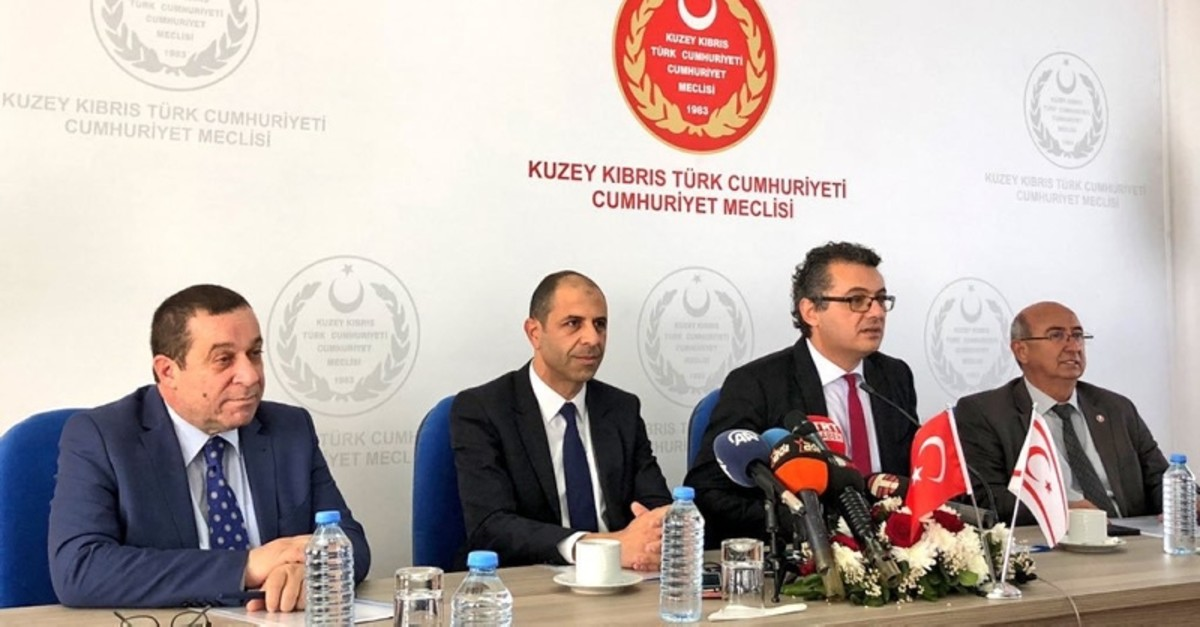 From left, DP's Serdar Denktau015f, HP's Kudret u00d6zersay, CTP's Tufan Erhu00fcrman and TDP's Cemal u00d6zyiu011fit sign the coalition protocol in Nicosia, TRNC, Feb. 1, 2018. (DHA Photo)