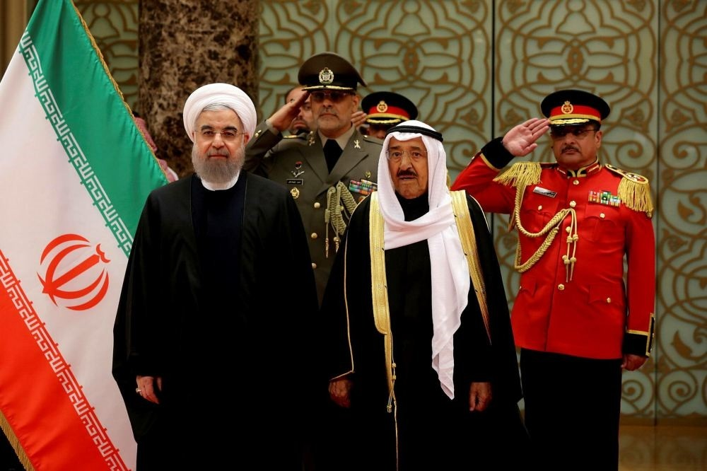 Iran's President Hassan Rouhani stands next to Emir of Kuwait Sheikh Sabah al-Ahmad al-Sabah during a welcoming ceremony in Kuwait City, Kuwait, Feb. 15.