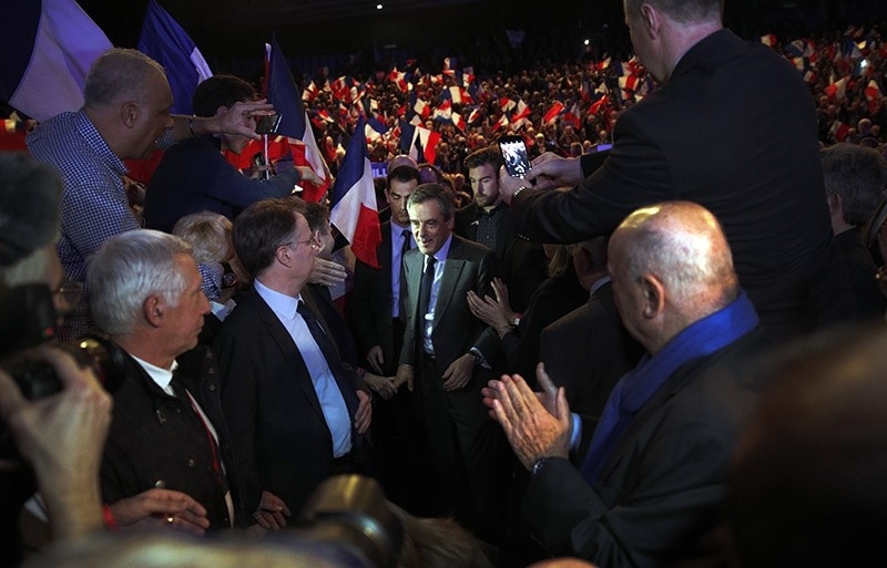 French conservative presidential candidate Franu00e7ois Fillon, center, arrives to deliver his speech during a rally in Orleans, central France, Tuesday, March 7, 2017. (AP Photo)