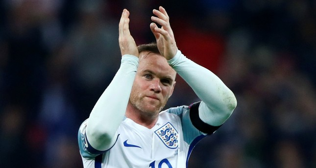 England's Wayne Rooney applauds fans after the game. (REUTERS Photo)