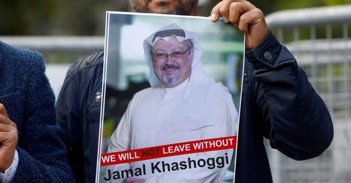 A demonstrator holds photo of Saudi journalist Jamal Khashoggi during a protest in front of Saudi Arabia's consulate, Istanbul, Oct. 5, 2018. (Reuters Photo)