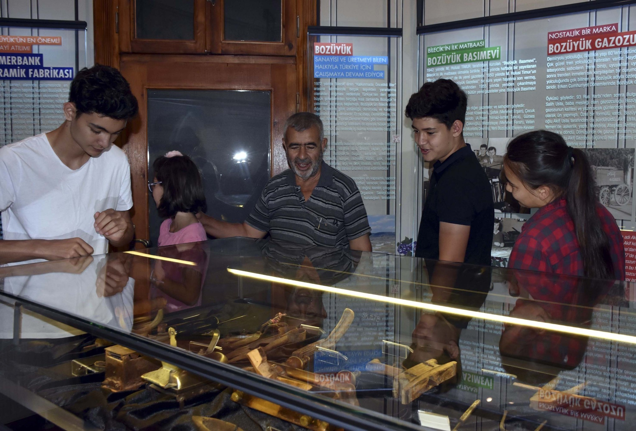Visitors look at works at the Bozu00fcyu00fck City Museum.