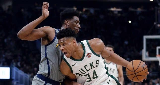 Milwaukee Bucks' Giannis Antetokounmpo (34) drives to the basket against Indiana Pacers' Thaddeus Young during the second half of their matchup in Milwaukee, March 7, 2019.