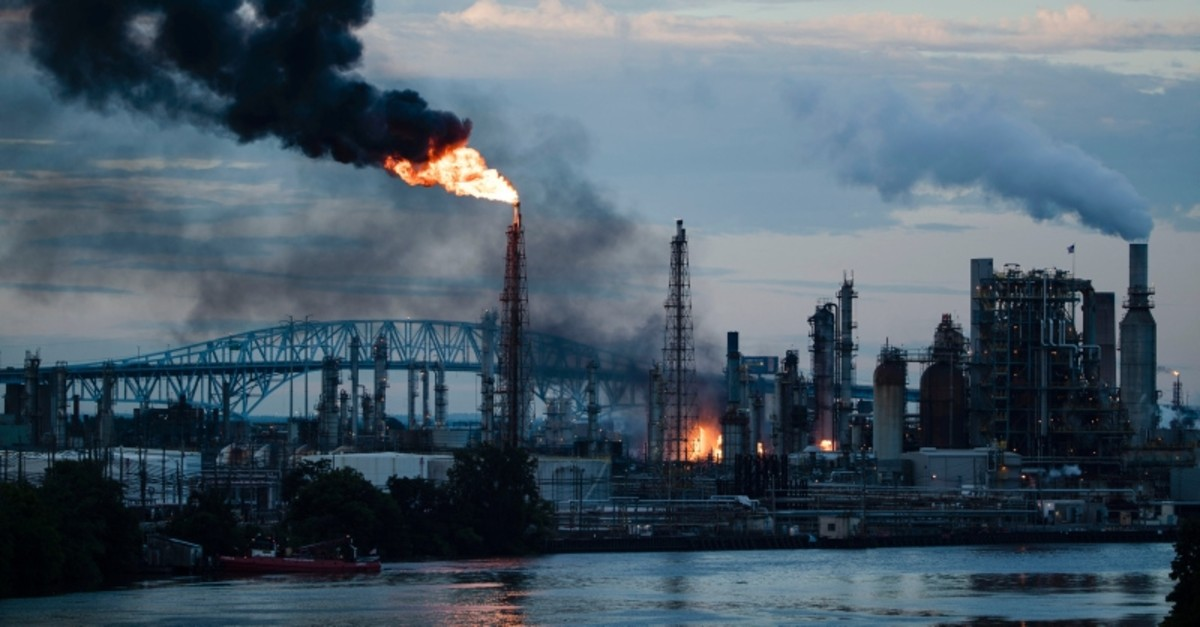 Flames and smoke emerge from the Philadelphia Energy Solutions Refining Complex in Philadelphia, Friday, June 21, 2019. (AP Photo)