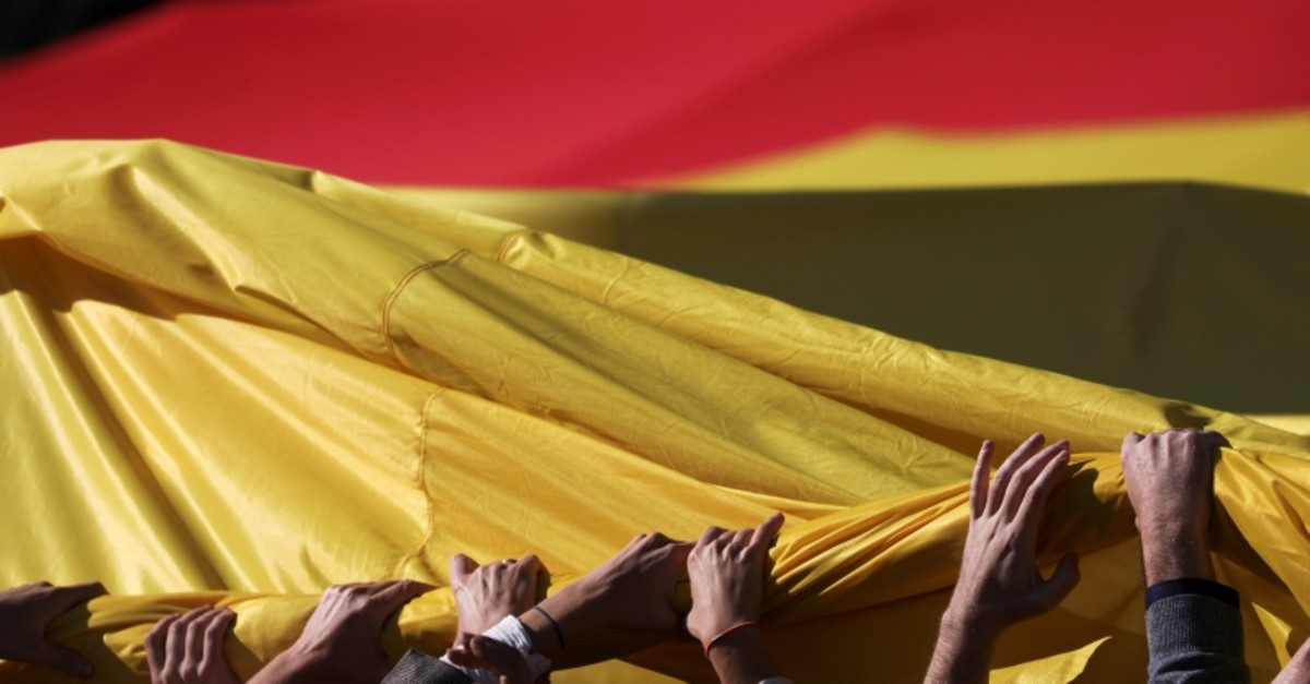 People hold a giant Spanish flag during a rally called by far-right party Vox in support of Spain's unity at Colon Square in Madrid, Spain, Oct. 26, 2019. (Reuters Photo)