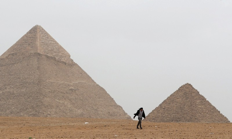 A man walks in front of the Great Pyramids in Giza, on the outskirts of Cairo, Egypt February 15, 2019. (Reuters Photo)