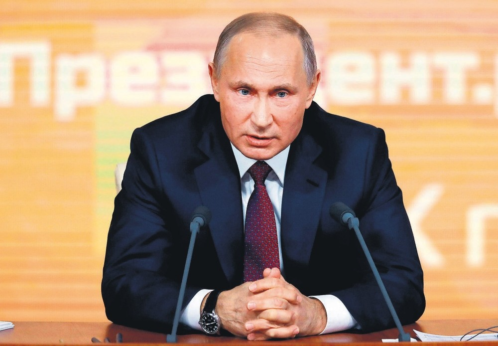 Russian President Vladimir Putin speaks during his annual end-of-year news conference in Moscow, Dec. 14.