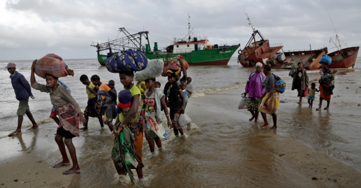 Displaced families arrive after being rescued by boat from a flooded area of Buzi district, 200 kilometers (120 miles) outside Beira, Mozambique, on Saturday, March 23, 2019. (AP Photo)