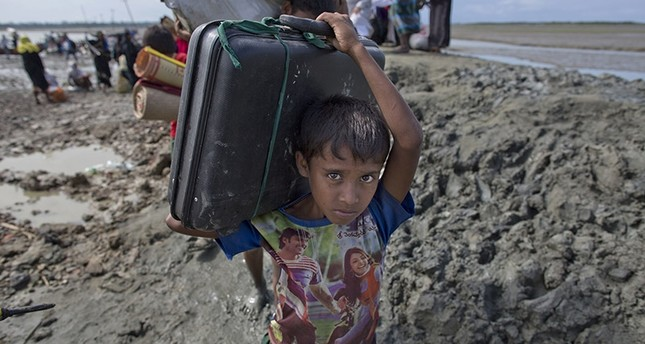 A newly arrived Rohingya Muslim boy from Myanmar walks towards a camp for refugees in Teknaf, Bangladesh, Friday, Sept. 29, 2017. (AP Photo)