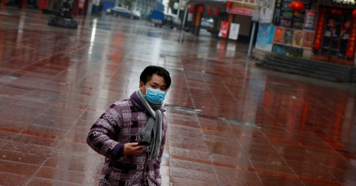 A man wearing a face mask walks in a deserted shopping area in Jiujiang, Jiangxi province, China, as the country is hit by an outbreak of the novel coronavirus, February 2, 2020. (Reuters Photo)