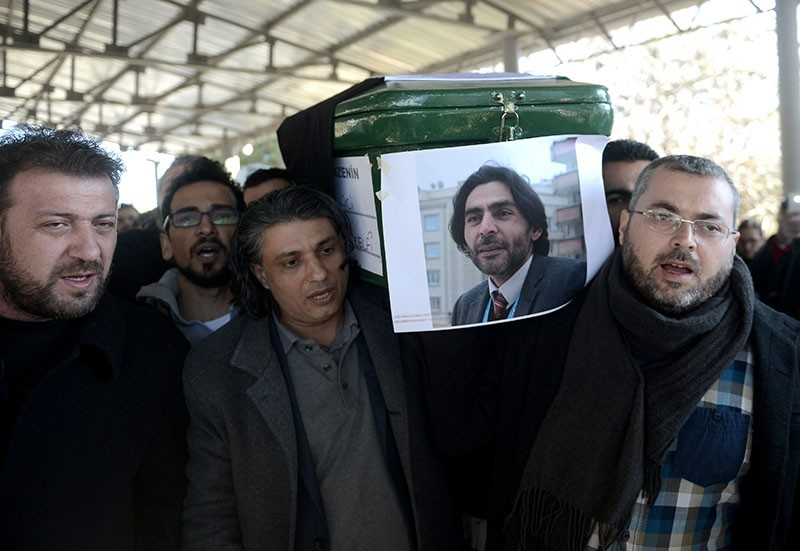 Family and friends of the murdered Syrian activist Naji al-Jerf carry his coffin after the funeral prayer, Jan. 11, 2016. (AA Photo)