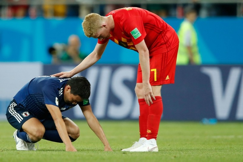 Japan's defender Gen Shoji is comforted by Belgium's midfielder Kevin De Bruyne at the end of the Russia 2018 World Cup round of 16 football match between Belgium and Japan at the Rostov Arena in Rostov-On-Don on July 2, 2018. (AFP Photo)