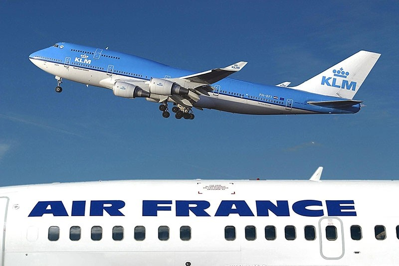 File photo taken January 1, 2003 at Schiphol Airport in Amsterdam shows a KLM Boeing 747-400 flying over an Air-France plane. (AFP Photo)