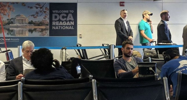 Special Counsel Rober Mueller (R) and Donald Trump Jr. (2nd L wearing a blue polo shirt) were photographed at the same gate at Reagan National Airport in Washington. (Source: Politico Playbook)