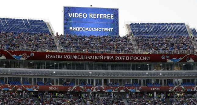 A giant screen reports an incident is being investigated by VAR (Video Assistant Referee) during the Confederations Cup match between Germany and Cameroon at the Fisht Stadium in Sochi.