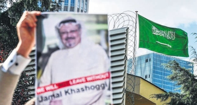 A demonstrator holds a poster with a picture of killed Saudi journalist Jamal Khashoggi outside the Saudi Arabia Consulate, Istanbul.