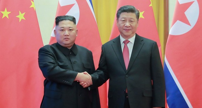 North Korea's visiting leader Kim Jong Un L shaking hands with China's President Xi Jinping R during a welcome ceremony at the Great Hall of the People in Beijing, January 8, 2019. AFP Photo