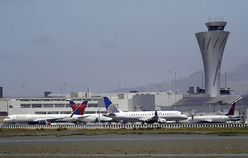 Departing and parked aircraft intersect at San Francisco International Airport, Tuesday, July 11, 2017, in San Francisco. (AP Photo)