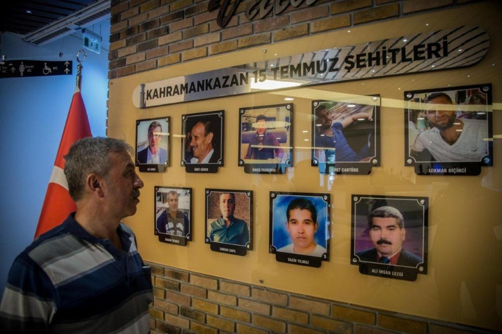 Cengiz u00d6ztu00fcrk is look at a showboard in the Kahramankazan Municipality Building where the names and photographs of people killed from the district during the coup attempt are exhibited.