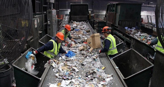 Workers sort recyclable waste at a facility. Turkey started a zero waste project last year to alleviate landfill use and boost recycling.