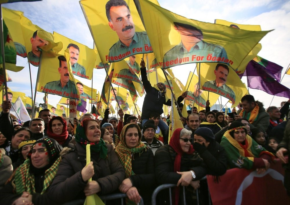 Pkk sympathizers hold flags featuring pkk leader Abdullah u00d6calan, in Cologne, Germany, Nov. 12, 2016.
