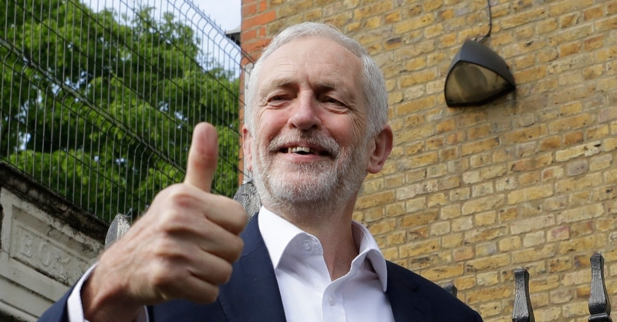 Jeremy Corbyn leader of Britain's opposition Labour Party gives the thumbs up after voting in the European Elections in London, Thursday, May 23, 2019. (AP Photo)