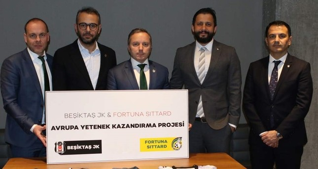 Beşiktaş and Fortuna Sittard officials pose after the signing in Istanbul, Jan. 9, 2020. AA Photo