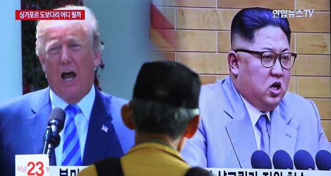 n this May 13, 2018, file photo, a man watches a TV screen showing file footage of U.S. President Donald Trump, left, and North Korean leader Kim Jong Un during a news program at the Seoul Railway Station in Seoul, South Korea. (AP Photo)