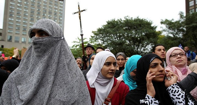 Women in traditional garb gather to protest against Quebec's proposed Charter of Values, Montreal, Canada, Sept. 14, 2013. (Reuters Photo)