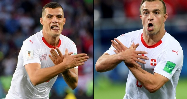 A combo of two pictures shows the celebration for the first goal of Switzerland's midfielder Granit Xhaka, (L), and the victory goal of Switzerland's midfielder Xherdan Shaqiri, (R).