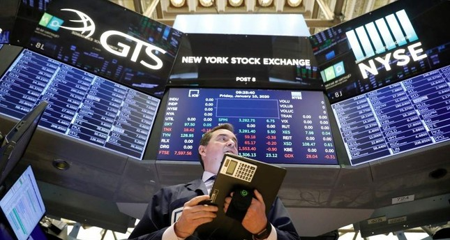 Traders work on the floor at the New York Stock Exchange NYSE in New York, U.S., Jan. 10, 2020. Reuters Photo
