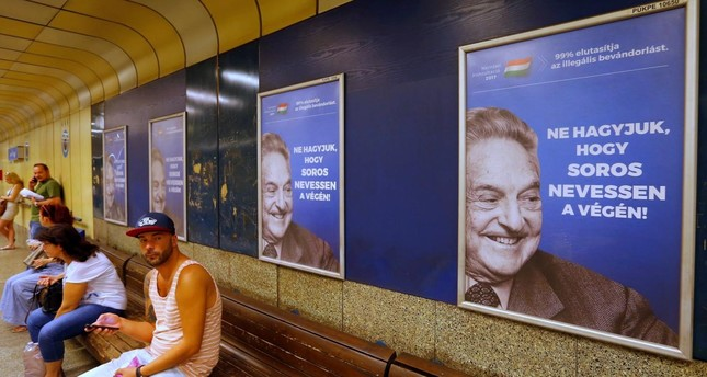 Hungarian government poster portraying financier George Soros and saying Don't let George Soros have the last laugh is seen at an underground stop in Budapest, Hungary July 11, 2017. Reuters Photo