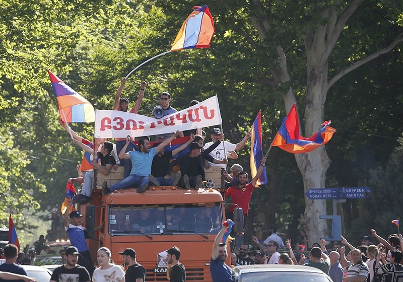 Armenian opposition supporters ride on a truck along a street after protest movement leader Nikol Pashinyan announced a nationwide campaign of civil disobedience in Yerevan, Armenia, May 2, 2018. (Reuters Photo)