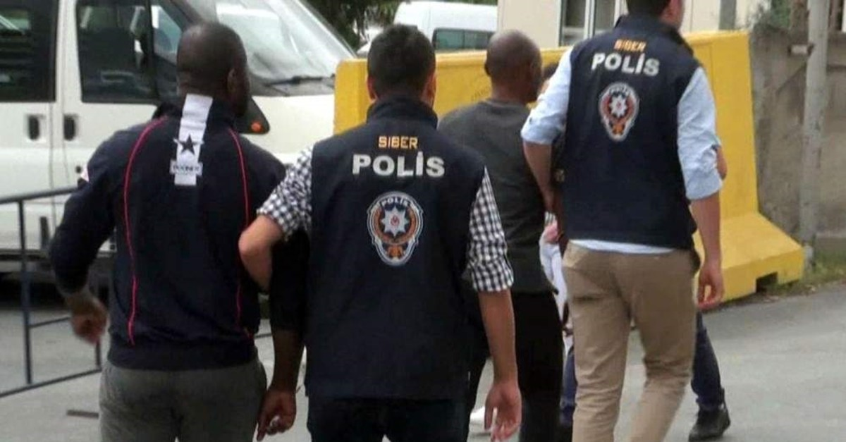 Istanbul police escort Nigerian suspects in another operation against a fraud gang in this 2018 photo. (PHOTO BY EM?R SOMER)