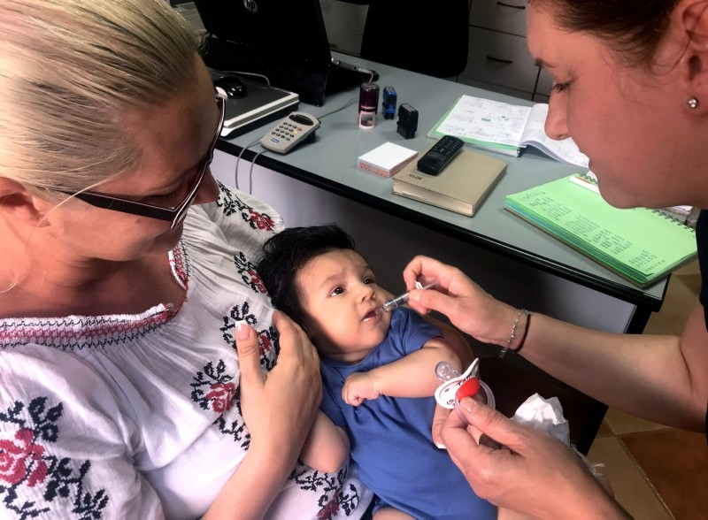 In this photo taken on Wednesday, June 6, 2018 picture, a child gets a dose of vaccine in Chitila, Romania. (AP Photo)