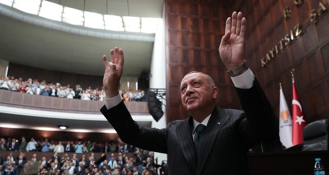 President Recep Tayyip Erdoğan salutes his party members during a party meeting in Ankara, June 25, 2019.