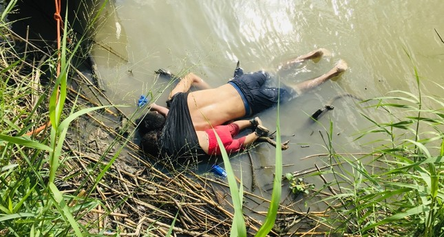 The bodies of Salvadoran migrant Oscar Alberto Martínez Ramírez and his nearly 2-year-old daughter Valeria lie on the bank of the Rio Grande in Matamoros, Mexico, Monday, June 24, 2019. (AP Photo/Julia Le Duc)