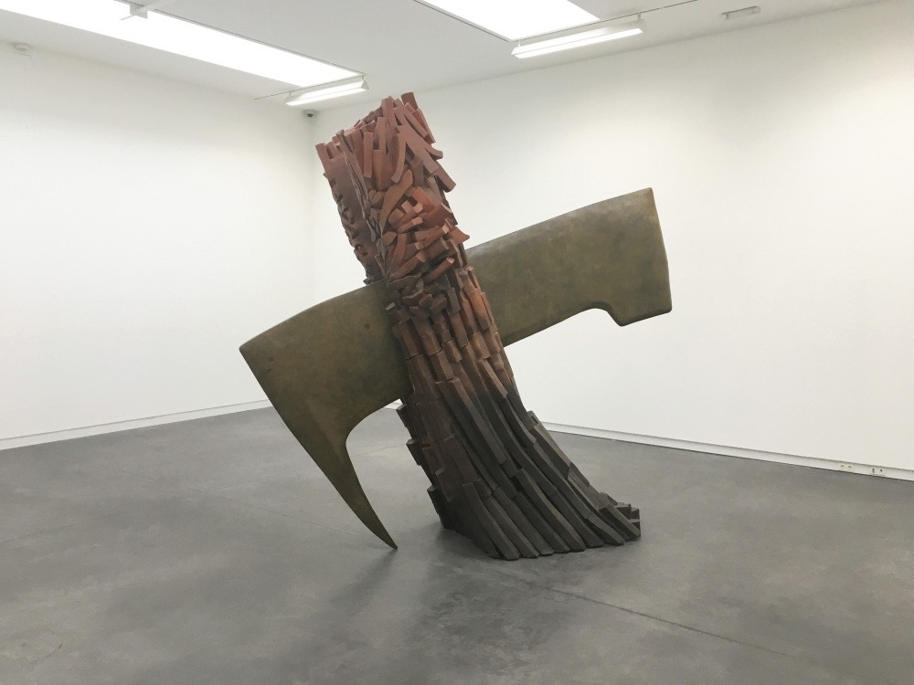 The giant 3-meter bronze monumental sculpture looks like a huge rock that has been bisected with an axe that doesnu2019t have a handle. The artist has frozen time and the viewer watches this moment by standing in front of it.