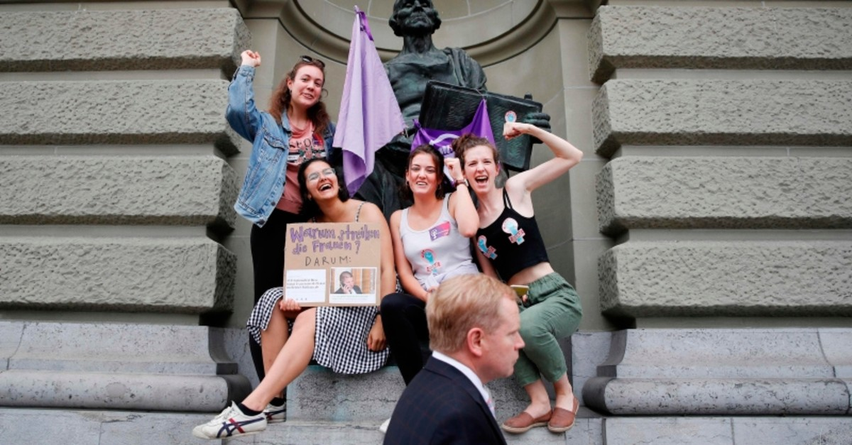 Women take part in a nation-wide women's strike for wage parity outside the federal palace, on June 14, 2019 in Swiss capital Bern. (AFP Photo)