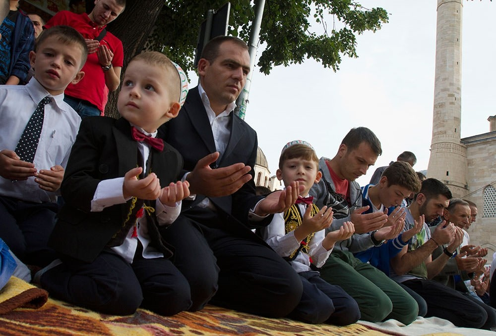 Kosovo Muslims offer Eid al-Fitr prayers outside the Sultan Mehmet Fatih grand mosque