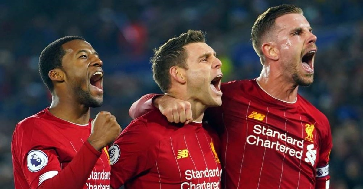 Liverpool players celebrate after scoring a penalty against Leicester City, Liverpool, Dec. 26, 2019 (EPA Photo)