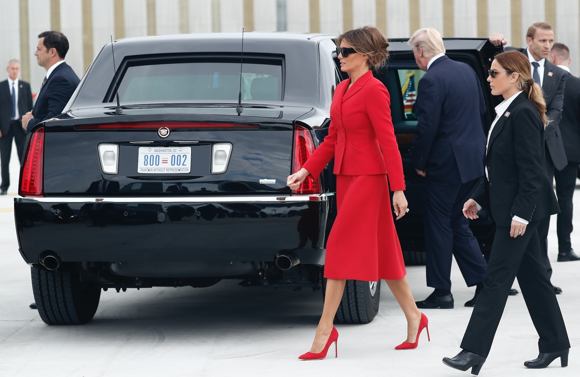 Melania Trump walks the tarmac after arriving in Paris, wearing Dior.