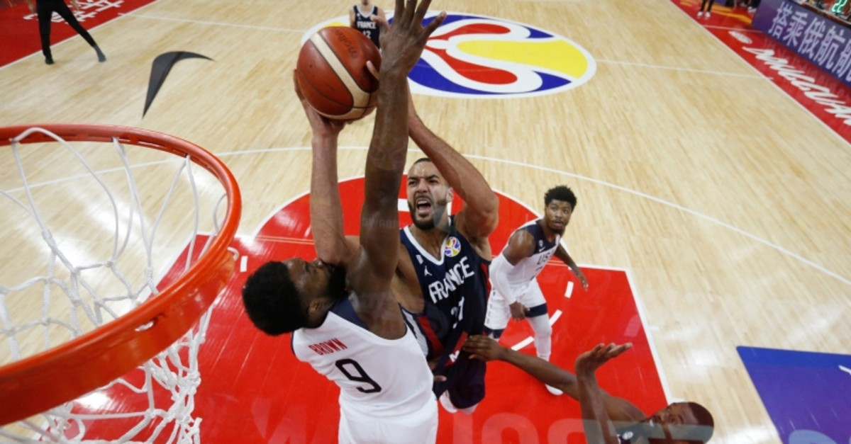 France's Rudy Gobert in action with Jaylen Brown of the U.S. during FIBA World Cup quarterfinal match at the Dongguan Basketball Center, Dongguan, China, September 11, 2019. (Reuters Photo)