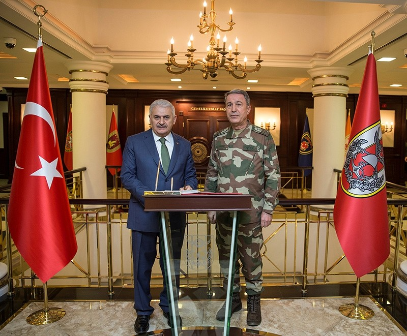 Prime Minister Binali Yu0131ldu0131ru0131m meets with Chief of the General Staff Hulusi Akar at the Armed Forces' headquarters in Ankara, Turkey January 20, 2018. (Photo courtesy of Prime Minister's Press Office)