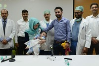A baby born with eight limbs, including two protruding from his stomach, has undergone surgery in India to successfully remove the extra arms and legs, in an operation being hailed as a world...