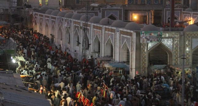 Pakistani devotees gather at the shrine of 13th century Muslim Sufi saint Lal Shahbaz Qalandar in Sehwan, some 200 kilometres (124 miles) northeast of Karachi, on the anniversary of the saint's death.