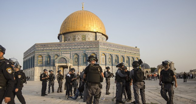 Israeli riot police take up positions next to Dome of the Rock at the Al-Aqsa Mosque compound in the Old City of Jerusalem, 27 July 2017, (EPA Photo).