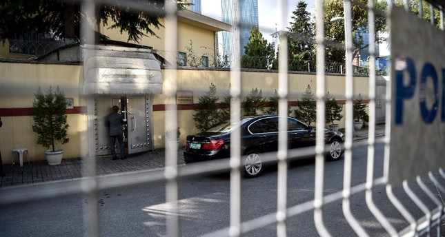 A security team member opens the door to the Saudi Consulate in Istanbul, where journalist Jamal Khashoggi was killed, Oct. 10.
