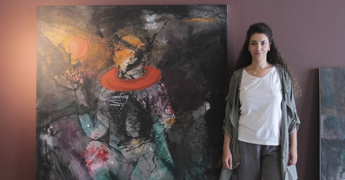Hiba Aizouq beside one of her artworks at CerModern.
